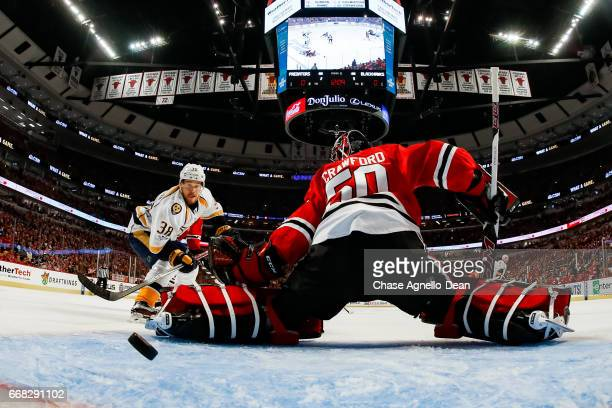 Viktor Arvidsson of the Nashville Predators scores the gamewinning goal on goalie Corey Crawford of the Chicago Blackhawks in the first period in...