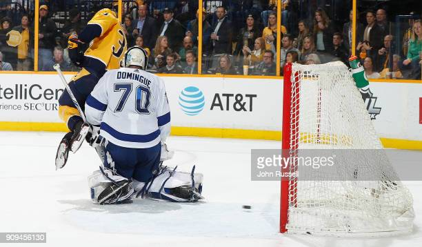 Viktor Arvidsson of the Nashville Predators screens goalie Louis Domingue of the Tampa Bay Lightning as a shot by PK Subban finds the back of the net...
