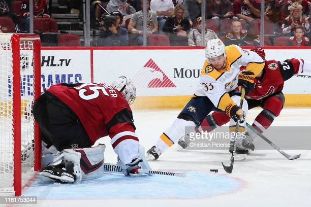 Viktor Arvidsson of the Nashville Predators skates in on goaltender Darcy Kuemper of the Arizona Coyotes during the second period of the NHL game at...