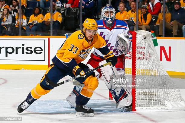 Viktor Arvidsson of the Nashville Predators skates past goalie Henrik Lundqvist of the New York Rangers during the first period at Bridgestone Arena...