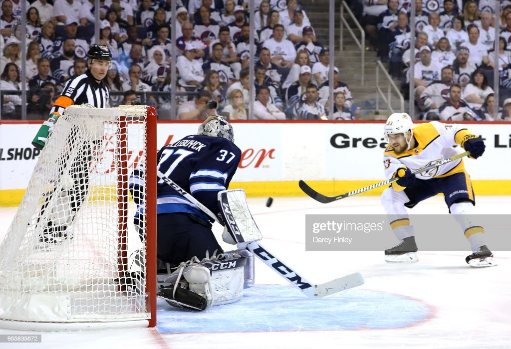 Viktor Arvidsson #33 of the Nashville Predators takes a shot on goaltender Connor Hellebuyck #37 of the Winnipeg Jets during third period action in Game Six of the Western Conference Second Round during the 2018 NHL Stanley Cup Playoffs at the Bell MTS Place on May 7, 2018 in Winnipeg, Manitoba, Canada.