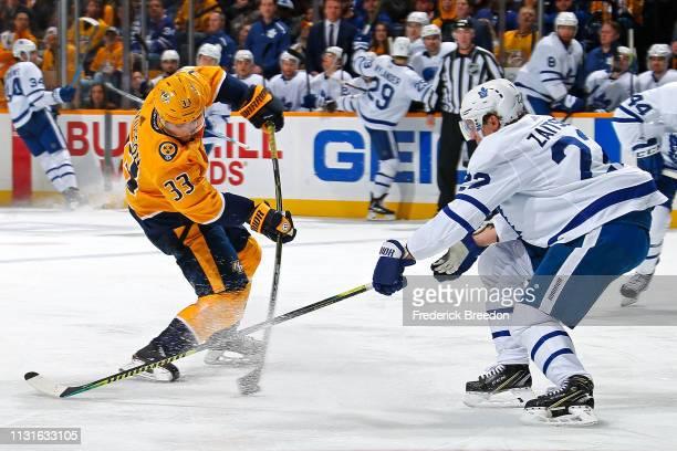 Viktor Arvidsson of the Nashville Predators takes a shot toward Nikita Zaitsev of the Toronto Maple Leafs during the third period at Bridgestone...