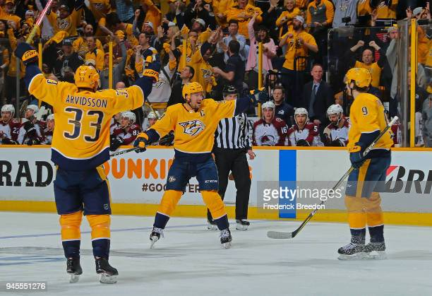 Viktor Arvidsson Roman Josi and Filip Forsberg of the Nashville Predators celebrate after a goal against the Colorado Avalanche during the third...