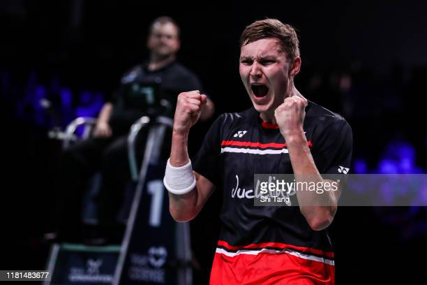 Viktor Axelsen of Denmark celebrates the victory in the Men's Singles first round match against Kenta Nishimoto of Japan on day two of the Denmark...