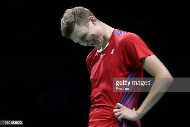 Viktor Axelsen of Denmark compete against Chen Long of China Chen Long of China in their Men's singles quarterfinals during the Total BWF World...