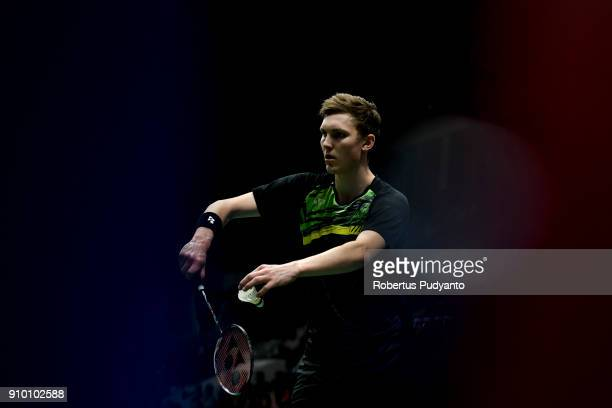 Viktor Axelsen of Denmark competes against Kazumasa Sakai of Japan during Men's Singles Round 16 match of the Daihatsu Indonesia Masters 2018 at...