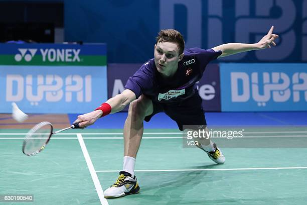 Viktor Axelsen of Denmark competes during men's singles final match against Tian Houwei of China on Day 5 of the BWF Dubai World Superseries Finals...