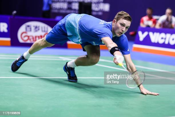 Viktor Axelsen of Denmark competes in the Men's Singles first round match against Kanta Tsuneyama of Japan on day one of the China Open at Olympic...