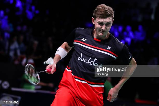 Viktor Axelsen of Denmark competes in the Men's Singles first round match against Kenta Nishimoto of Japan on day two of the Denmark Open at Odense...