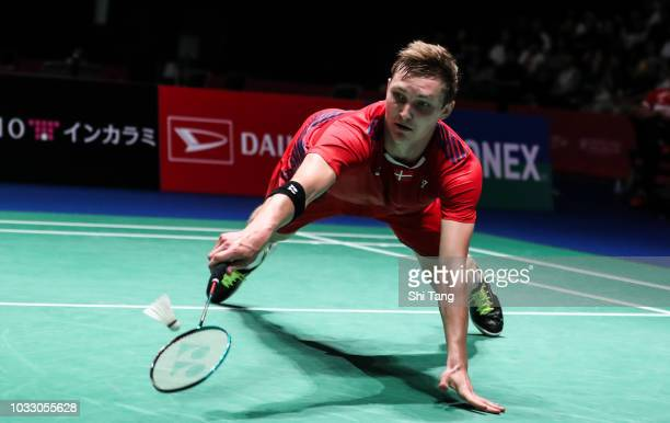 Viktor Axelsen of Denmark competes in the Men's Singles quarter finals against Anthony Sinisuka Ginting of Indonesia on day four of the Yonex Japan...