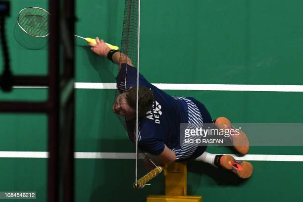 TOPSHOT Viktor Axelsen of Denmark crashes on the net during the men's singles match against Lee Zii Jia of Malaysia at the Malaysia Masters badminton...