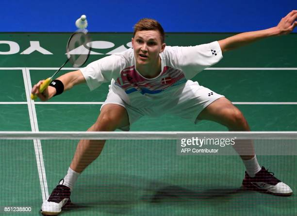 Viktor Axelsen of Denmark hits a return against Srikanth Kidambi of India during their men's singles quarterfinal match at the Japan Open Badminton...