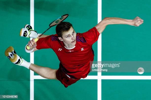 Viktor Axelsen of Denmark hits a shot against Chen Long of China in their men's singles quarterfinals during the Badminton World Championships at...