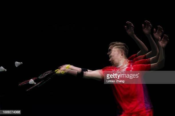 Viktor Axelsen of Denmark hits a shot against Ng Ka Long Angus of Hong Kong in their Men's singles match during the Badminton World Championships at...