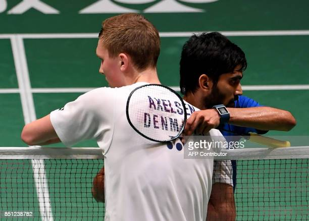 Viktor Axelsen of Denmark is congratulated by Srikanth Kidambi of India after winning their men's singles quarterfinal match at the Japan Open...