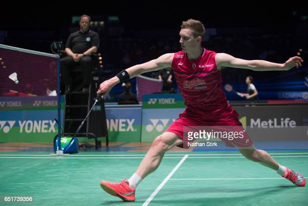 Viktor Axelsen of Denmark plays his quarter final match against Lin Dan of China during the YONEX All England Open Badminton Championships at...