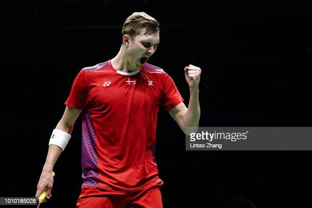 Viktor Axelsen of Denmark reacts as he competes against Chen Long of China in their men's singles quarterfinals during the Badminton World...