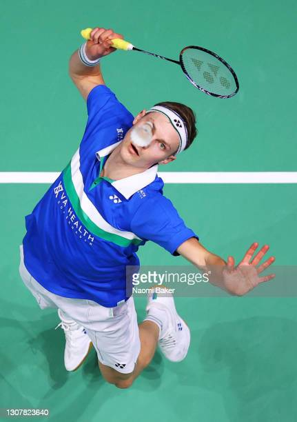 Viktor Axelsen of Denmark returns a shot during his round of 16 match against Bhamidipati Sai Praneeth of India during day two of YONEX All England...