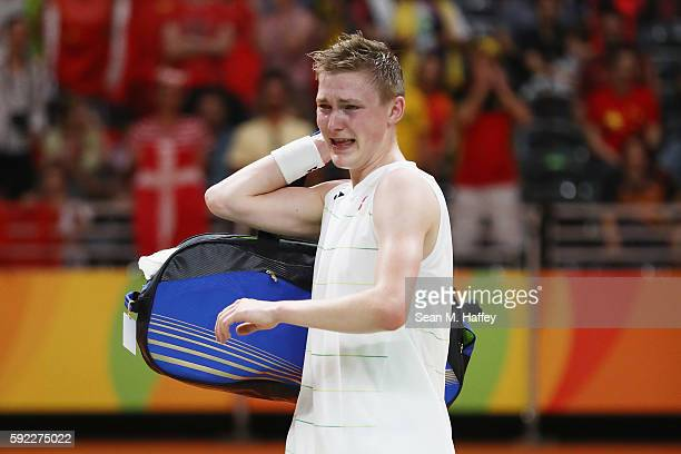 Viktor Axelson of Denmark celebrates victory over Dan Lin of China during the Men's Singles Badminton Bronze Medal match on Day 15 of the Rio 2016...