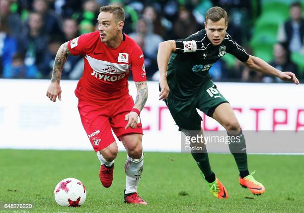 Viktor Claesson of FC Krasnodar is challenged by Andrey Yeshchenko of FC Spartak Moscow during the Russian Premier League match between FC Krasnodar...