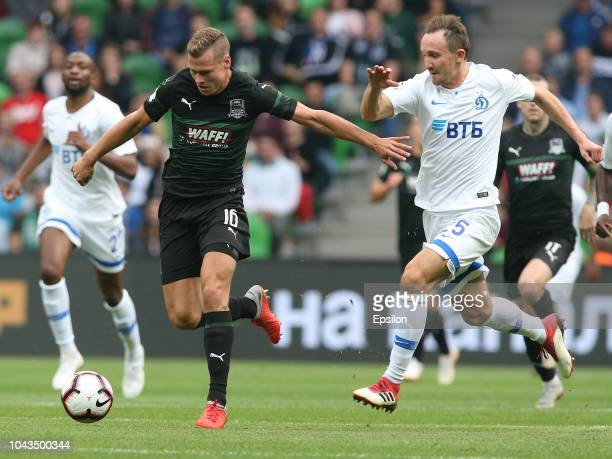 Viktor Claesson of FC Krasnodar vies for the ball with Aleksei Kozlov of FC Dinamo Moscow during the Russian Premier League match between FC...
