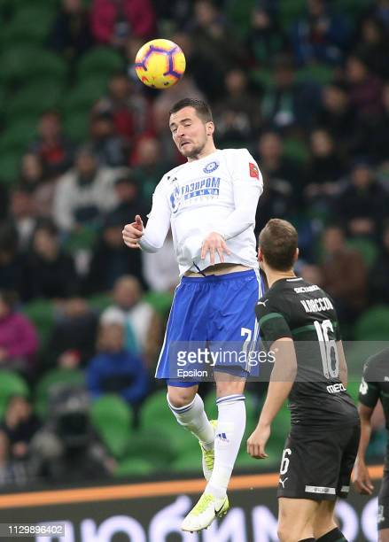 Viktor Claesson of FC Krasnodar vies for the ball with Dorde Despotovic of FC Orenburg during the Russian Premier League match between FC Krasnodar v...