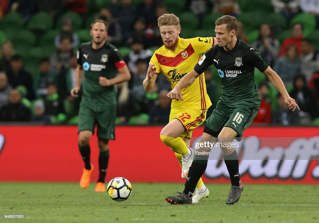 Viktor Claesson (R) of FC Krasnodar vies for the ball with Ivan Novoseltsev of FC Arsenal Tula during the Russian Premier League match between FC Krasnodar v FC Arsenal Tula at Krasnodar Stadium on April 14, 2018 in Krasnodar, Russia.