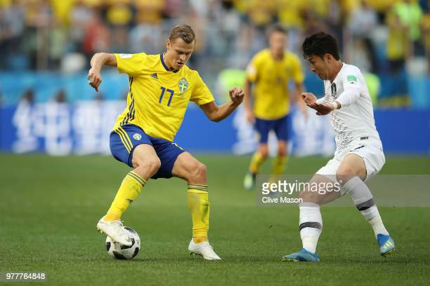 Viktor Claesson of Sweden and Son HeungMin of Korea Republic battle for the ball during the 2018 FIFA World Cup Russia group F match between Sweden...
