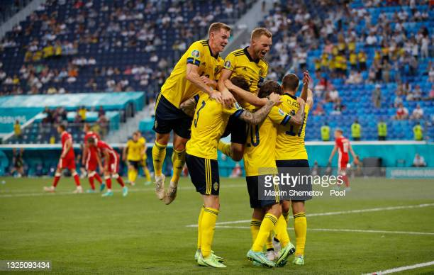Viktor Claesson of Sweden celebrates with teammates after scoring their side's third goal during the UEFA Euro 2020 Championship Group E match...