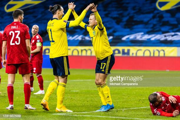 Viktor Claesson of Sweden embraces teammate Zlatan Ibrahimovic after scoring the 1-0 goal during the FIFA World Cup 2022 Qatar qualifying match...