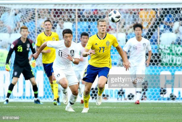 Viktor Claesson of Sweden Hwang Heechan of South Korea during the 2018 FIFA World Cup Russia group F match between Sweden and Korea Republic at...