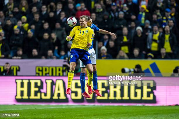 Viktor Claesson of Sweden in an arial duel during the FIFA 2018 World Cup Qualifier PlayOff First Leg between Sweden and Italy at Friends arena on...