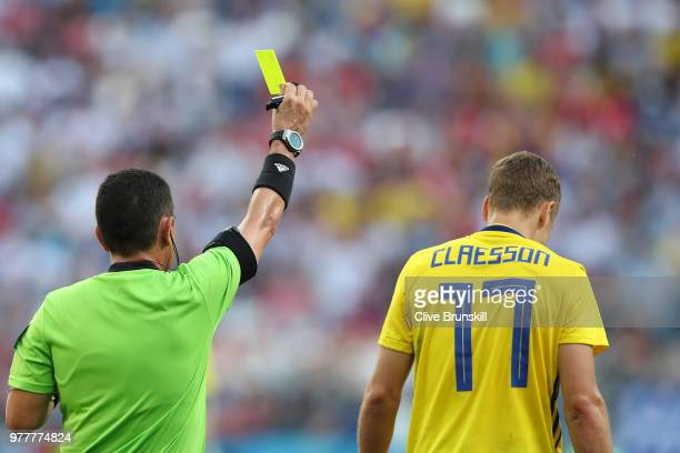 Viktor Claesson of Sweden is shown a yellow card by Referee Joel Aguilar during the 2018 FIFA World Cup Russia group F match between Sweden and Korea...