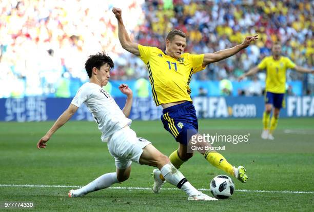 Viktor Claesson of Sweden is tackled by Lee JaeSung of Korea Republic during the 2018 FIFA World Cup Russia group F match between Sweden and Korea...