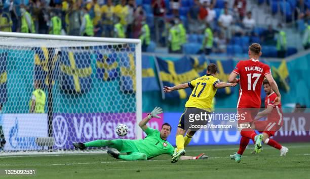 Viktor Claesson of Sweden scores their side's third goal past Wojciech Szczesny of Poland during the UEFA Euro 2020 Championship Group E match...