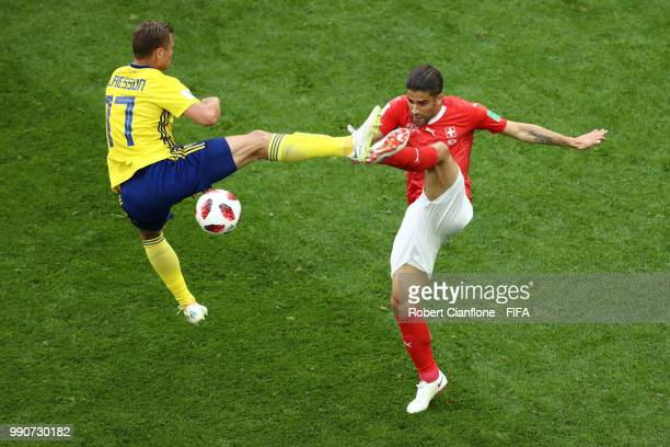 Viktor Claesson of Sweden tackles Ricardo Rodriguez of Switzerland during the 2018 FIFA World Cup Russia Round of 16 match between Sweden and...