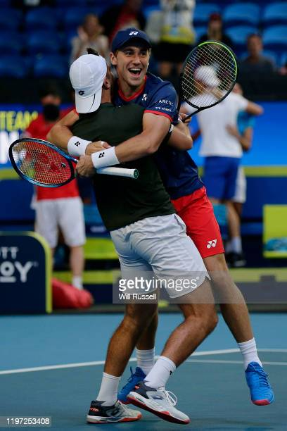 Viktor Durasovic and Casper Ruud of Norway celebrate after defeating Austin Krajicek and Rajeev Ram of USA during day one of the 2020 ATP Cup Group...