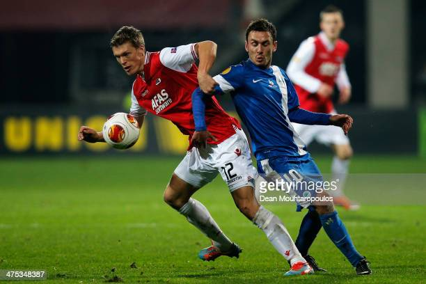 Viktor Elm of AZ is tackled by Serhiy Rybalka of Slovan Liberec during the UEFA Europa League Round of 32 match between AZ Alkmaar and FC Slovan...