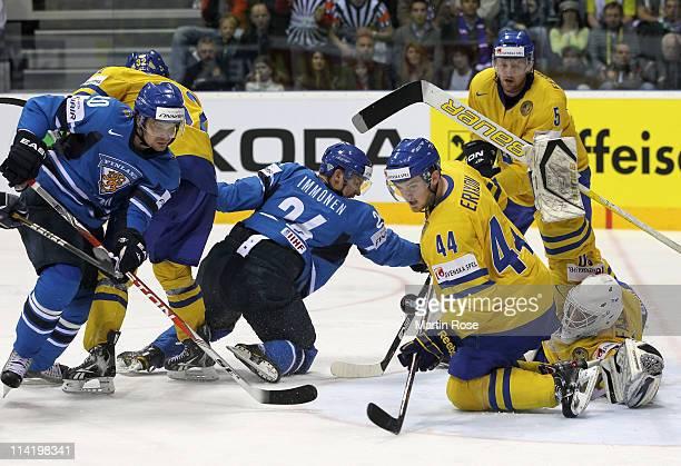Viktor Fasth , goaltender of Sweden makes a save against Jarkko Immonen of Finland during the IIHF World Championship gold medal match between Sweden...