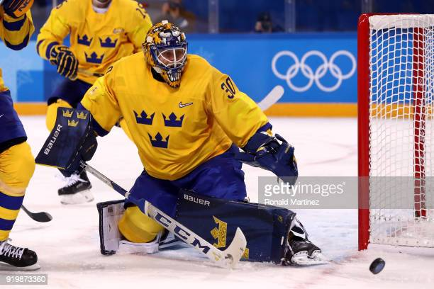 Viktor Fasth of Sweden makes a save in the third period against Finland during the Men's Ice Hockey Preliminary Round Group C game on day nine of the...