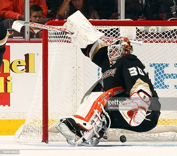 Viktor Fasth of the Anaheim Ducks can't stop the puck during the game against the San Jose Sharks on March 25 2013 at Honda Center in Anaheim...