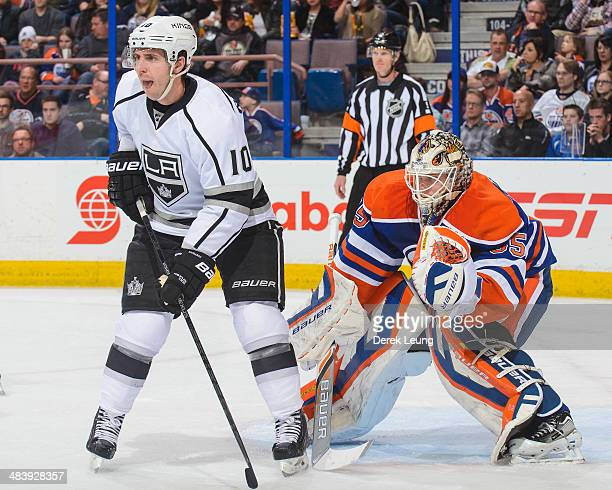 Viktor Fasth of the Edmonton Oilers defends net against Mike Richards of the Los Angeles Kings during an NHL game at Rexall Place on April 10 2014 in...