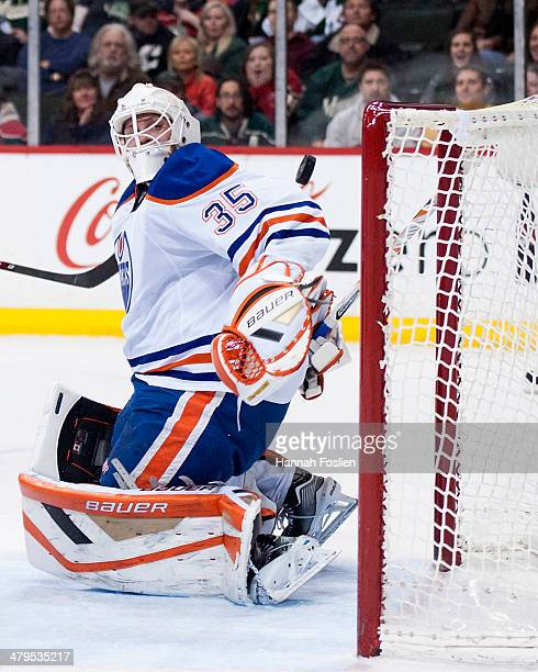 Viktor Fasth of the Edmonton Oilers defends the net during the game against the Minnesota Wild on March 11 2014 at Xcel Energy Center in St Paul...