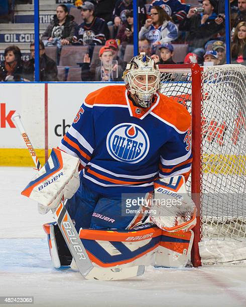 Viktor Fasth of the Edmonton Oilers in action against the Calgary Flames during an NHL game at Rexall Place on March 22 2014 in Edmonton Alberta...