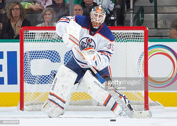 Viktor Fasth of the Edmonton Oilers makes a play on the puck against the Dallas Stars at the American Airlines Center on November 25 2014 in Dallas...
