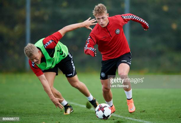 Viktor Fischer and Andreas Cornelius compete for the ball during the Denmark training Session at Dragor Stadion on October 2 2017 in Dragor Denmark