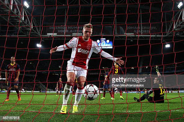 Viktor Fischer collects the ball from the net after Danny Hoesen of Ajax shoots and scores the second goal of the game during the UEFA Champions...