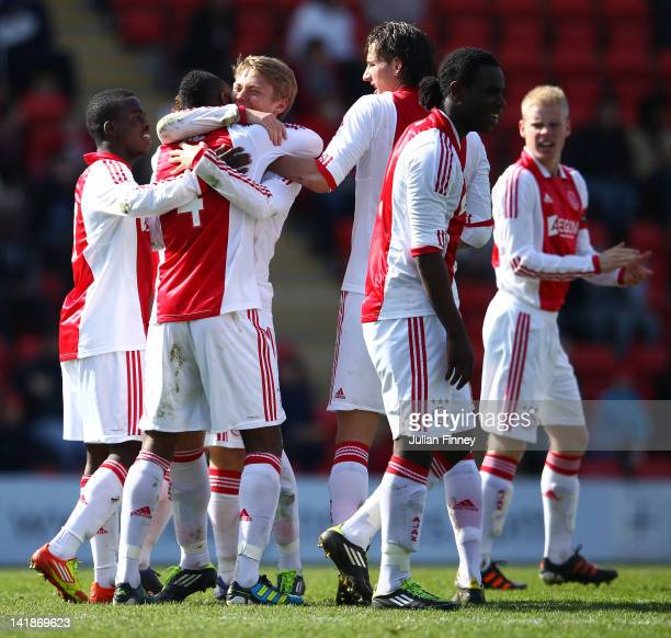 Viktor Fischer hugs goalscorer Stefane Denswil of Ajax during the NextGen Series Final between Ajax U19 and Inter Milan U19 at Matchroom Stadium on...