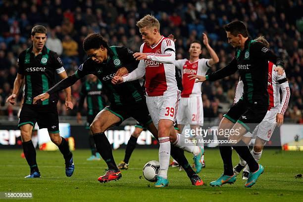 Viktor Fischer of Ajax and Virgil van Dijk and Nick Bakker of Groningen battle for the ball during the Eredivisie match between Ajax Amsterdam and FC...