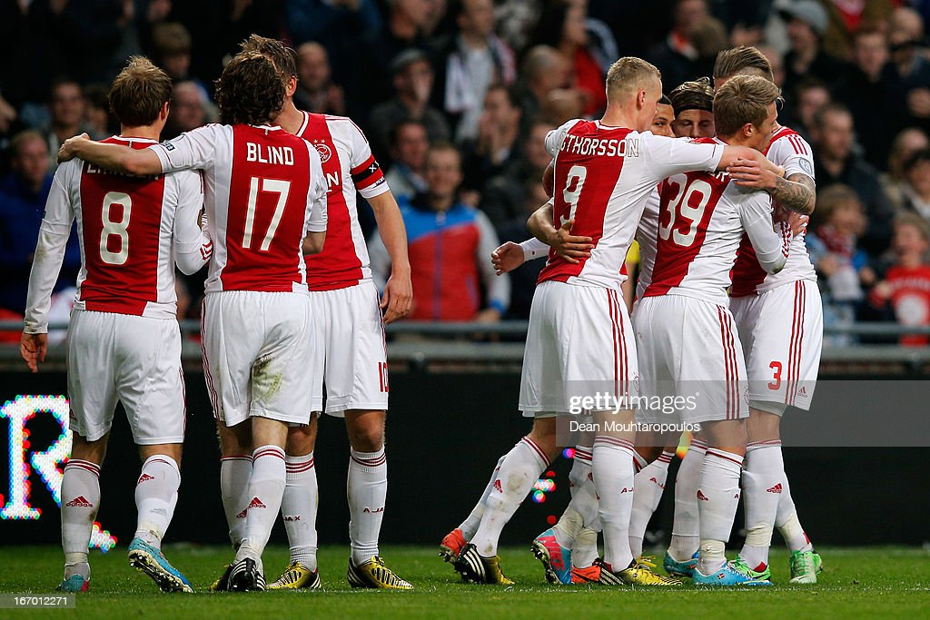 Viktor Fischer (#39) of Ajax is congratulated by team mates after he heads and scores the first goal of the game during the Eredivisie match between Ajax Amsterdam and SC Heerenveen at Amsterdam Arena on April 19, 2013 in Amsterdam, Netherlands.